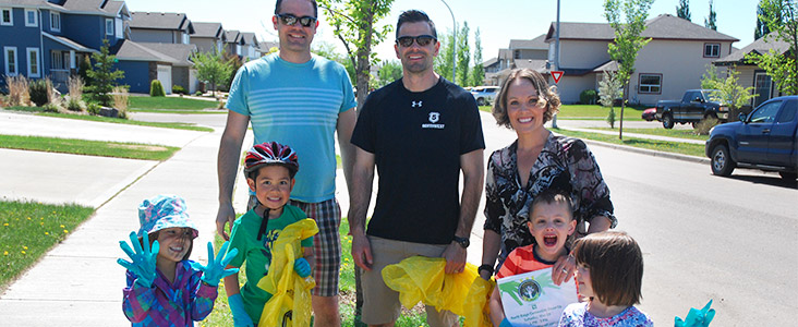 Families smiling with bags