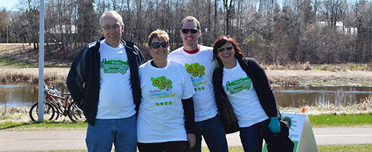 Photo of four adults volunteering at Spruce Up