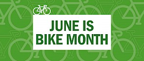 Green background with illustration of bikes on top and the words - June is bike month