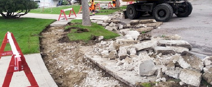 Photo of a sidewalk being repairs with the old sidewalk in pieces