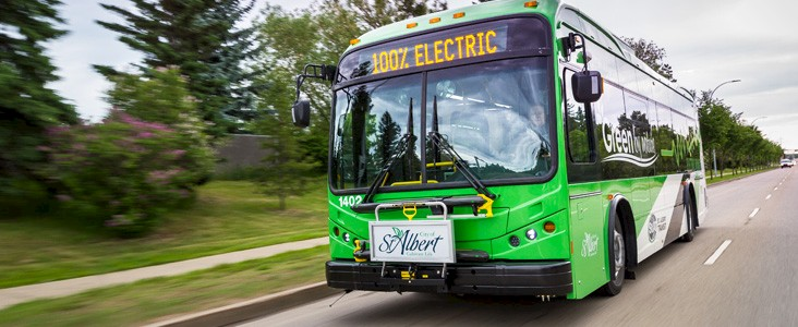 Photo of a St. Albert Transit electric bus driving on a street