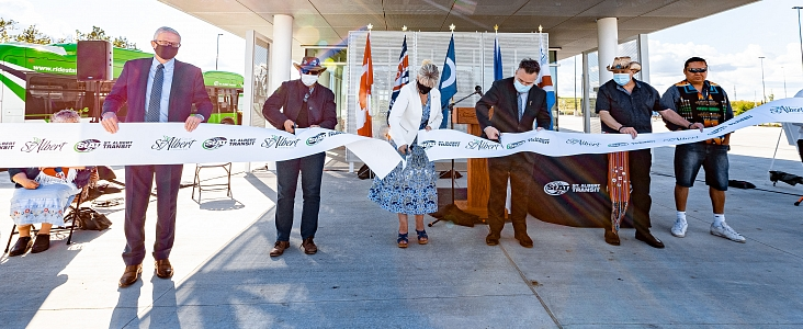 Mayor Heron and dignitaries cutting a ribbon at the Nakî Transit Centre & Park and Ride event