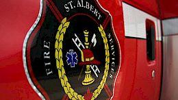 A close up of the Fire Services emblem on a fire truck door