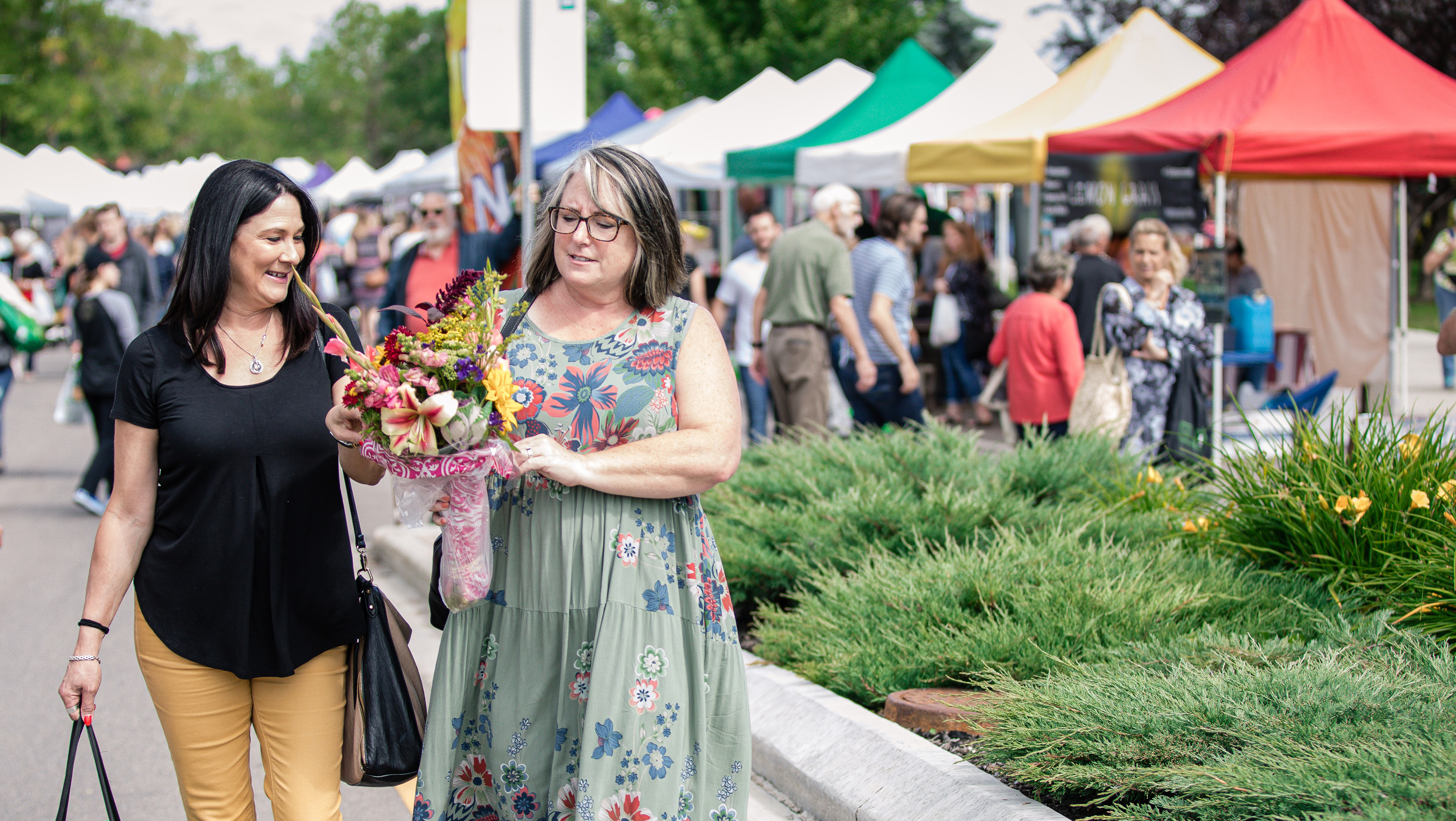 Customers enjoying St. Albert's thriving Farmer's Market