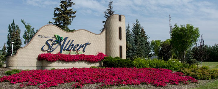 City of St. Albert entrance sign with pink flowers