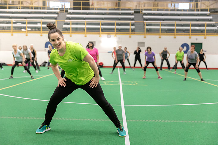 Fitness instructor leading dance class at Servus Place