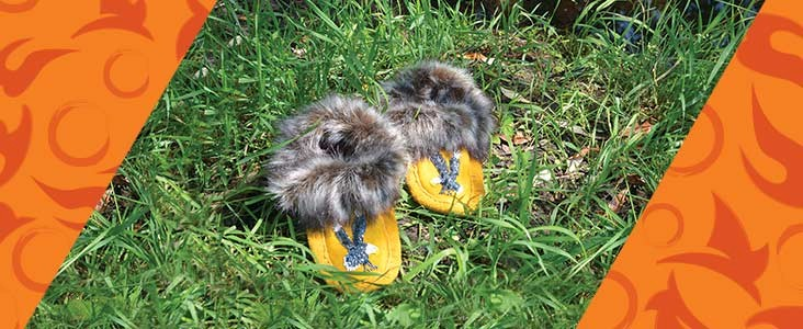 Moccasins sitting on grass