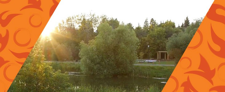 Looking across the Sturgeon River at the Healing Garden while the sun sets behind it