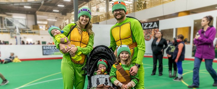 Family at dressed up in Halloween costume at Servus Place