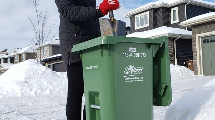 A shovel can loosen up the material inside the Green Organics Cart