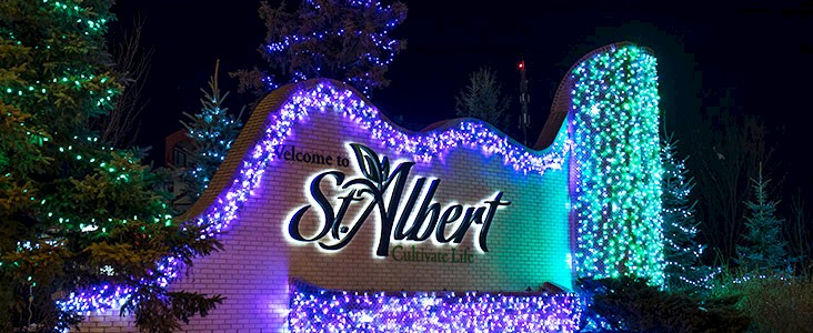 City of St. Albert welcome sign decorated in holiday lights