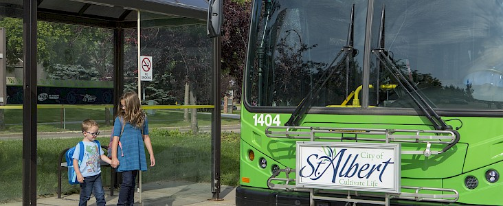 Two young siblings boarding a StAT bus