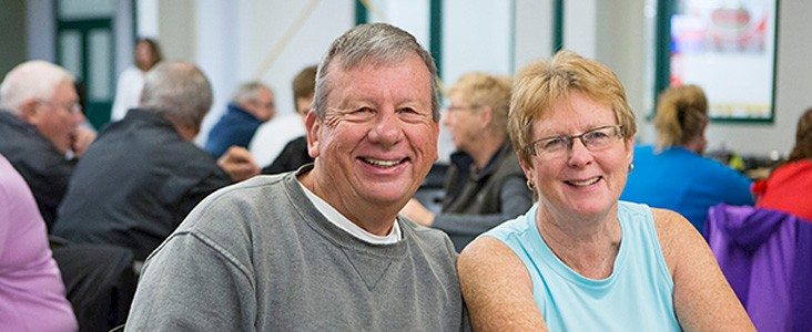 A pair of smiling seniors enjoying the day's events