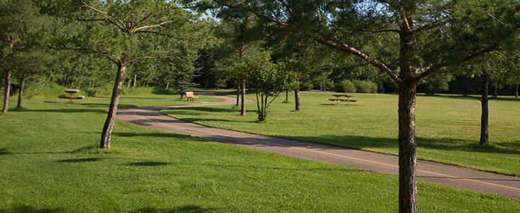 Walking trail and bench at beautiful Kingswood Park in Saint Albert, Alberta