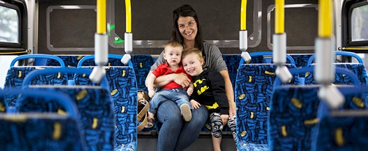 Family sitting inside a bus