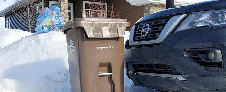 Incorrect placement of waste bin and recycling bag in front of vehicle