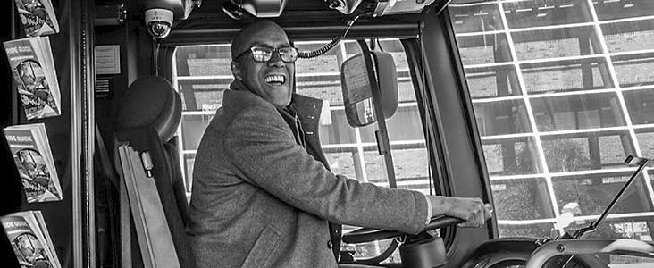 Councillor Watkins driving a city bus
