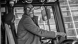 Councillor Watkins driving a city bus